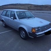 ford escort lx wagon  speed manual   mpg